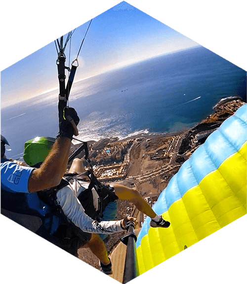 tandem paragliders over the coast