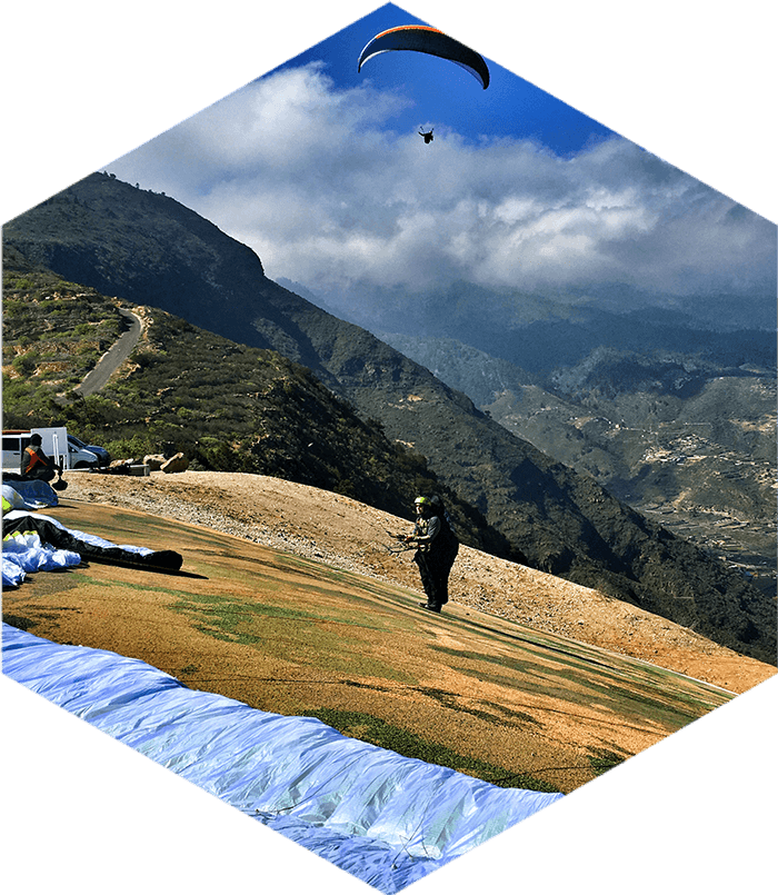 getting ready for paragliding take off on steep slope