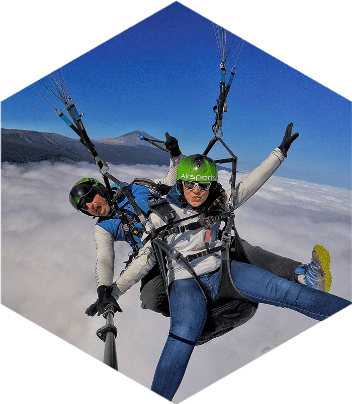 paragliding tandem flight above the clouds with Mount Teide in the background