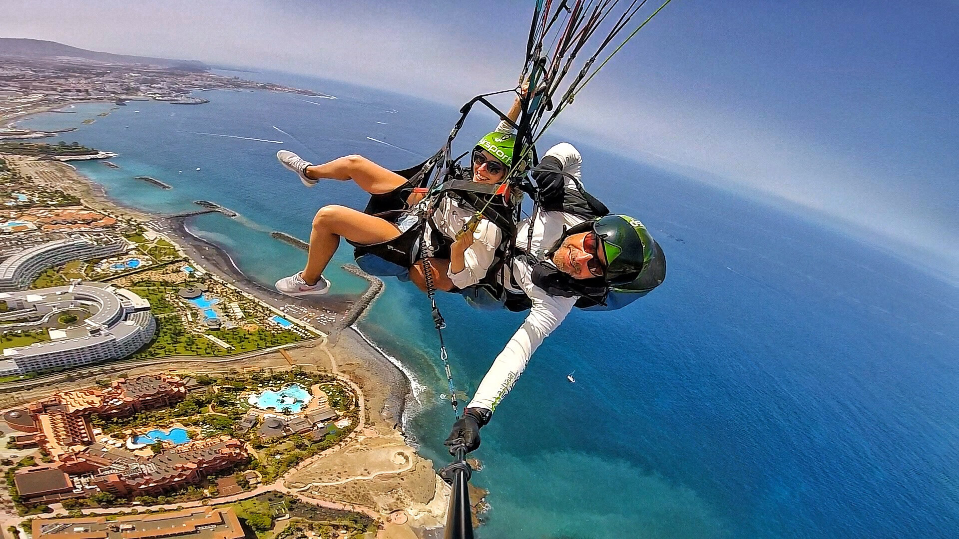 paragliding tandem above the hotels of costa adeje