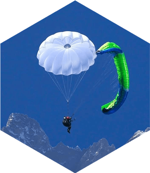 paraglider with white parachute open